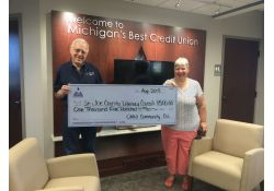 Omni Credit Union gives a Grant to the Literacy Council